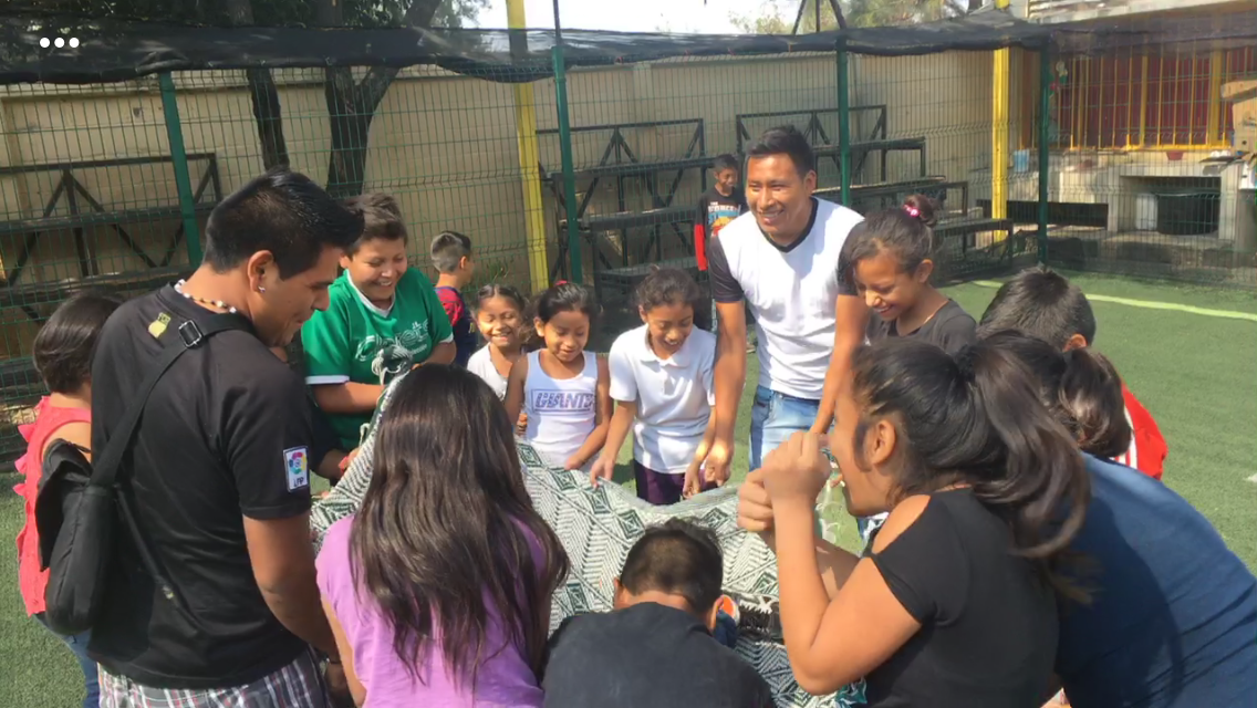Children at Caminando Unidos are participating in a group activity
